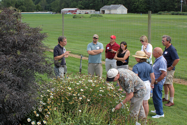 Brian Eshenaur, Ornamentals IPM Extension Area Educator with the NYSIPM Program, makes a point about insect and disease problems in the landscape.