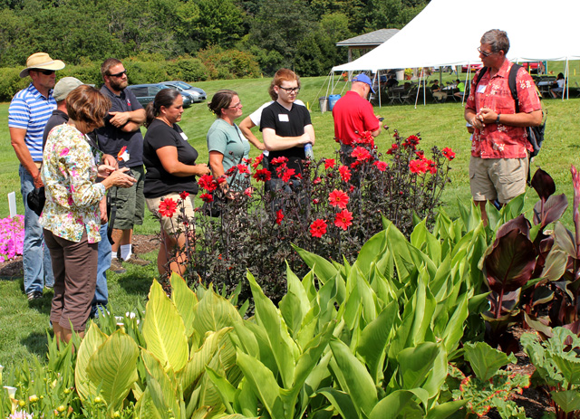 Bill Miller (right) talks about uses of summer bulbs -- such as dahlias and cannas.