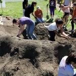 Shaping soil.
