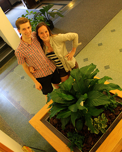 Matthew and Maddy with rejuvenated planter in Plant Science foyer.