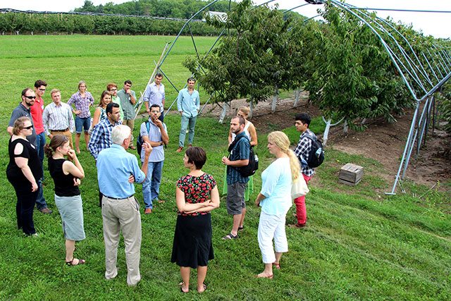 Horticulture graduate students learn about high tunnel cherry research.