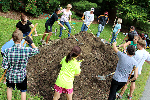 Students begin shaping the soil and compost.
