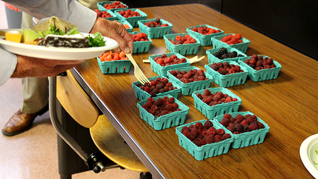 Speaker Weber brought raspberries from his variety trials for sampling at lunch.