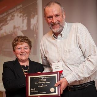 Dean Kathryn Boor presents 'Unsung Hero' award to Craig Cramer November 10.