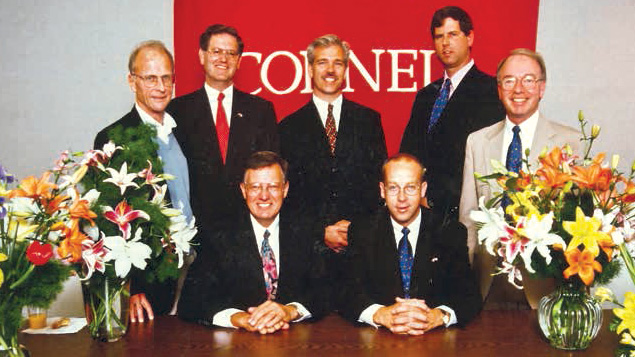 Among the attendees at the signing of the Anthos-Cornell research contract were horticulture professor Bob Langhans (left), CALS Dean Daryl Lund (front left), Bill Miller (second from right) and Floriculture and Ornamental Horticulture chair Tom Weiler (right).