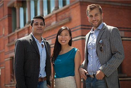 Abhijeet Bais, left, Margo Wu and Brennan Whitaker Duty, all MBA candidates who will graduate in May, won the 2015 New York Business Plan Competition, which carried a $100,000 grand prize. Jason Koski/University Photography