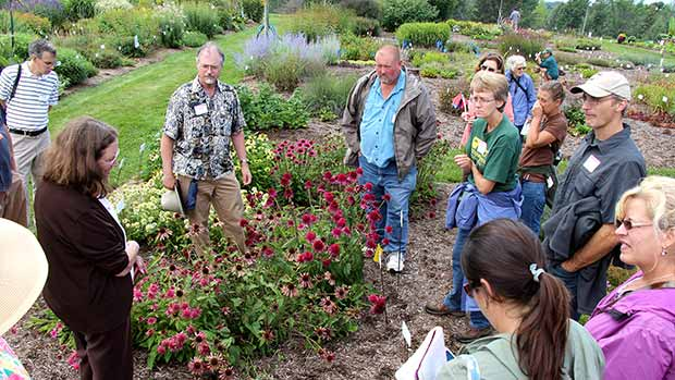 Plant pathologist Margery Daugherty and entomologist John Sanderson help attendees identify insect pests and diseases on perennials at Bluegrass Lane.