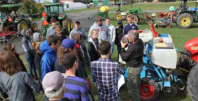 Students learn about vegetable production equipment at  Cornell's Thompson Research Farm in Freeville.