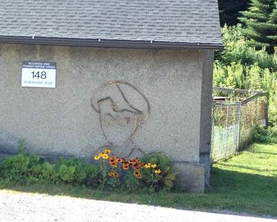 The McClintock Shed at the Cornell Plantations with David Zakalik's driftwood sculpture of  Nobel Laureate Barbara McClintock.