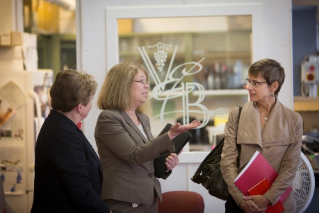 President Elizabeth Garrett, right, tours the Pilot Plant on the Geneva campus with College of Agriculture and Life Sciences Dean Kathryn Boor, left, and Susan Brown, associate dean and director of the New York State Agricultural Experiment Station in Geneva.