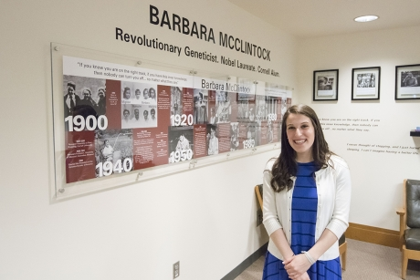 Juliet Jacobson '16 stands in front of the exhibit she designed for Nobel laureate Barbara McClintock in Mann Library. (Photo: Matt Hayes)