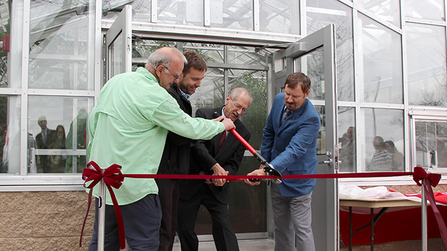 Kevin Nixon, Glenn Evans, Alan Collmer and Ed Cobb cut the ribbon.