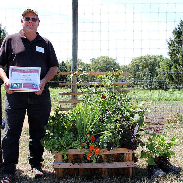 Donald Horowitz '77 (Floriculture and Ornamental Horticulture), Wittendale's Florist & Greenhouses, East Hampton, N.Y. took first place in the new Edibles Division in the 2015 Kathy Pufahl Memorial Container Design Competition.