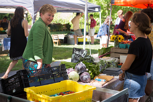 Kathryn Boor, the Ronald P. Lynch Dean of Agriculture and Life Sciences, stops by the Dilmun Hill farm stand during the Ag Quad Farmers Market, Sept. 1.