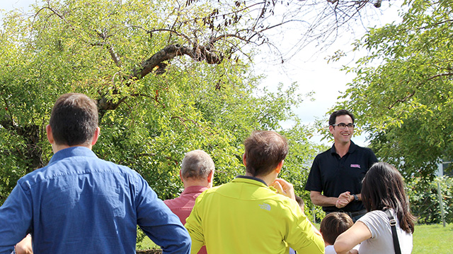 Assistant professor Greg Peck began the orchard tour in front of historic 100-year-old trees.