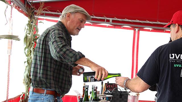 Horticulture professor emeritus Ian Merwin pours a sample of his Black Diamond Farm cider.
