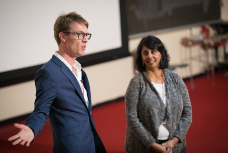 "Andrew Chignell, visiting associate professor in the Sage School of Philosophy, left, and Anu Rangarajan, director of the Cornell Small Farms Program, speak at the 2017 President's Council of Cornell Women Symposium, ""Feeding the World Sustainably."" (Photo: Chris Kitchen/University Photography)"