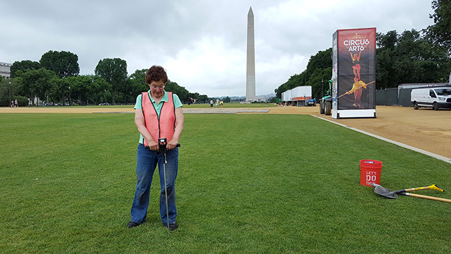 Bassuk uses a penetrometer to measure soil compaction on the National Mall in Washington, D.C. (Photo: Yoshiki Harada)