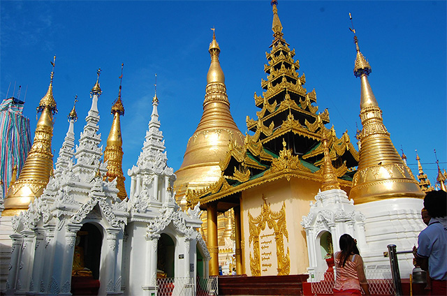 The Shwedagon Pagoda in Yangon which stands more than 300 feet tall and is covered with gold.