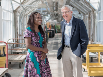 Kalenga Banda and professor emeritus Chris Wien, M.S. '67, Ph.D. '71 in the Kenneth Post Laboratory Greenhouse complex. Photo by Matt Hayes.