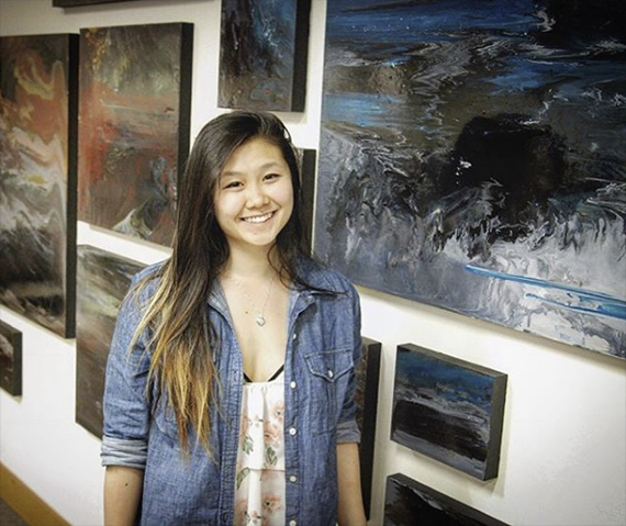 Viola Yu with her paintings in Mann Library.