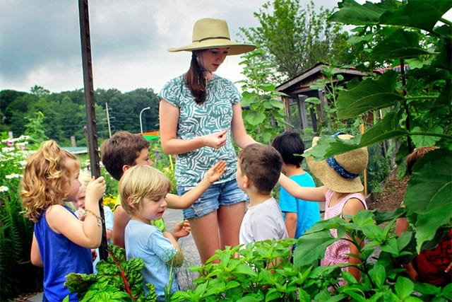 Bailee Hopkins-Hensley '18, MPS '19, is passionate about exploring the connections that humans have to plants – especially the connections that indigenous communities have to the species that sustain them. Above, Hopkins-Hensley works with local children while interning at the Ithaca Children's Garden in summer 2017. Photo provided