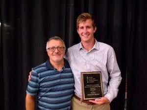 faculty member with award winner