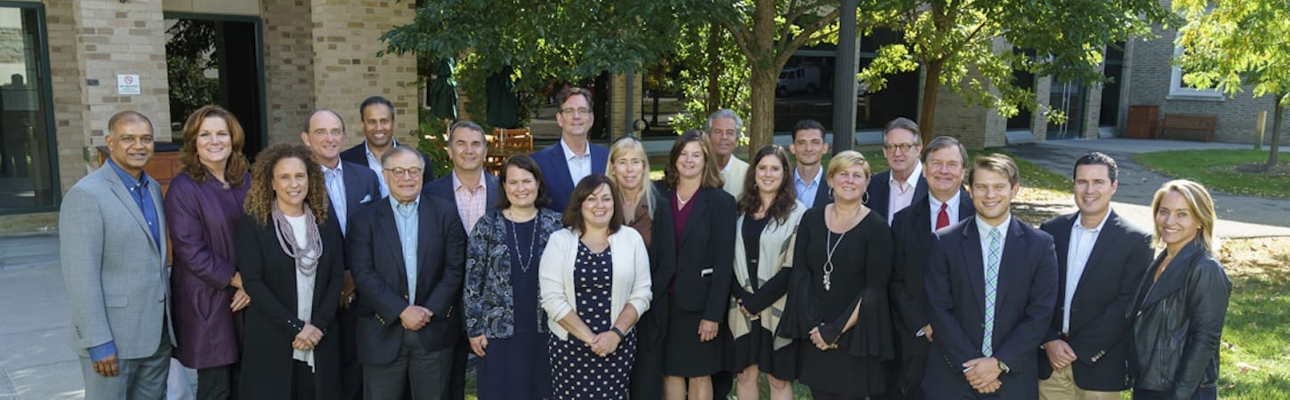 Photo of CIHF corporate members standing outside, posing for a photo