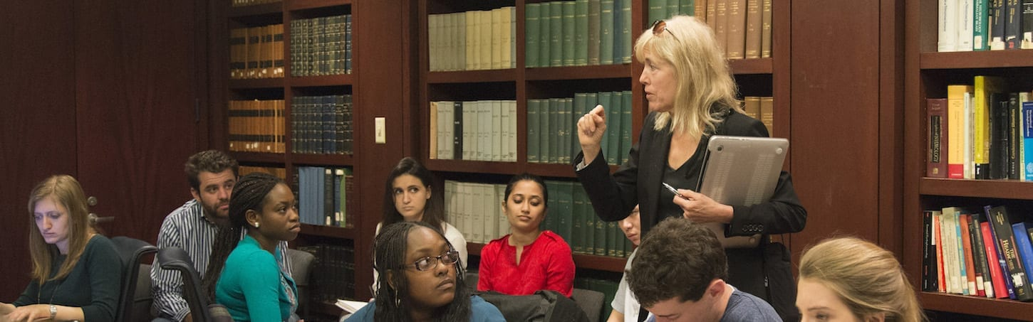 Photo of Mardelle Shepley lecturing students in a library