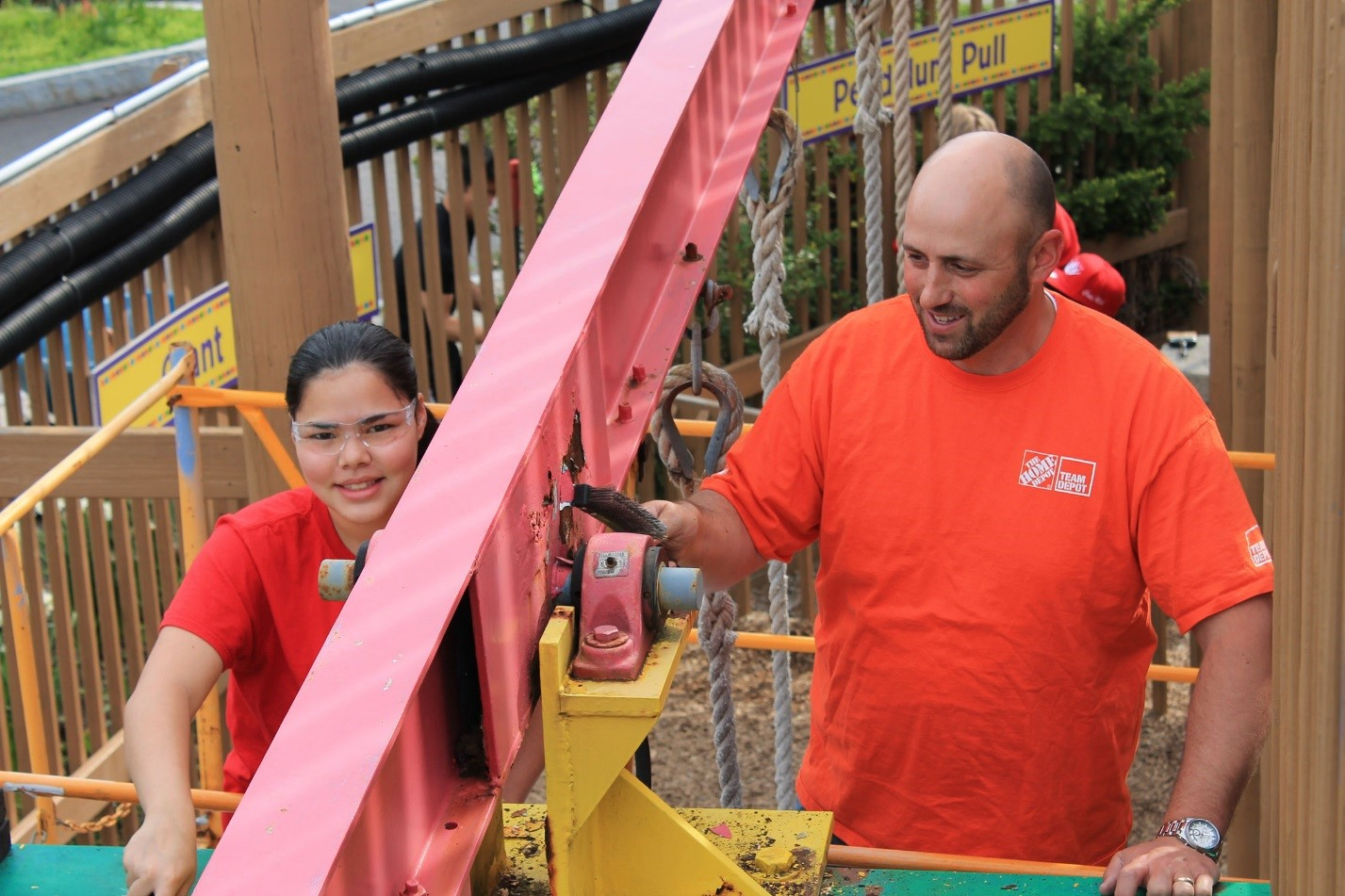 IHS junior Code Red member Abigail Lee and mentor Jim Bedore volunteer with Code Red at the Ithaca Sciencenter outdoor playground. Code Red frequently volunteers as a team around Ithaca, to clean up parks, work at the Ithaca Children's Gardens, and more.