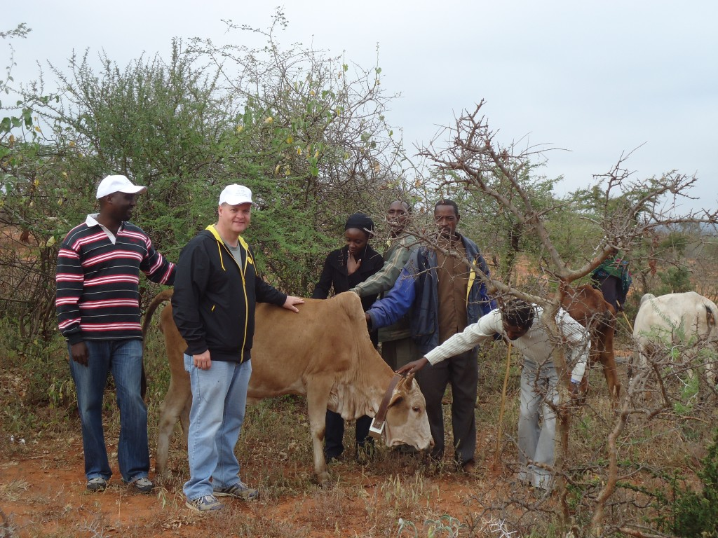 L-R: Andrew Mude (ILRI), Chris Barrett (Cornell University), Brenda Wandera (ILRI), two Ethiopian herders, Birhanu Taddesse (ILRI).  Dr. Mude working with colleagues from IRLI and Cornell University to retrofit and secure GPS-enabled tracking collars for cattle in the Borena region of Ethiopia.