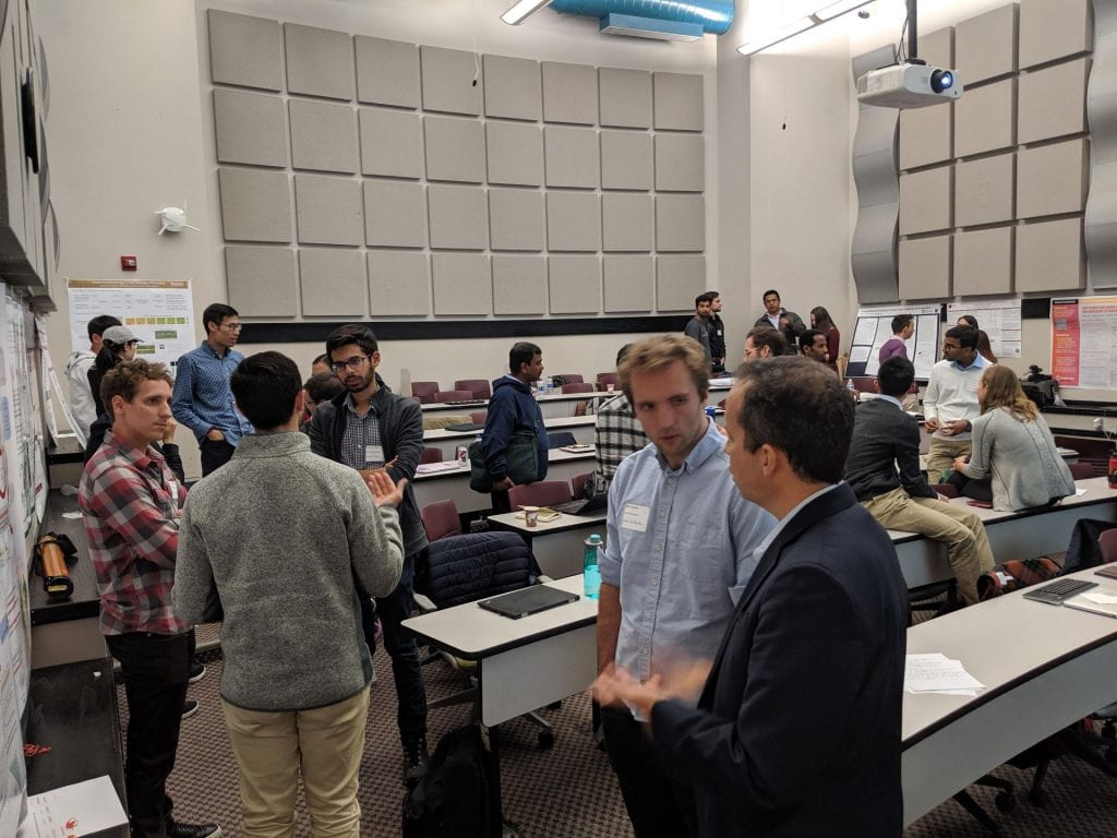 Participants chatting about their work during a poster session.