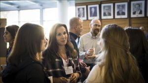 An alum discusses with students during the latest coffee and conversation event