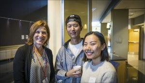Students and alumni smile at the camera during the latest Coffee and Conversations event