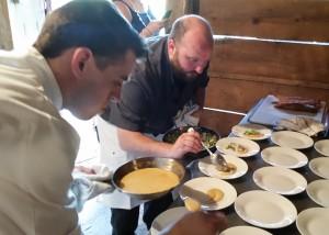 Chefs Sam Strock (left) and Josh Fidler (right) prepare small plates to begin the Rettland Farm Supper Club event.