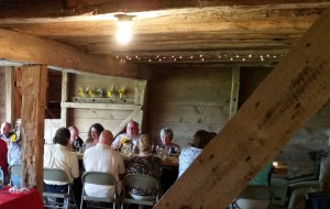 Dinner guests dining in the barn at Rettland Farm.