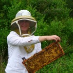 Erica Frenay of Shelterbelt Farm in Caroline, NY poses with her beautiful capped brood