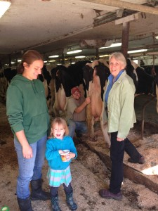 David invites guests to visit with the cows and help with daily chores in the barn. Photo by Rachel Carter.
