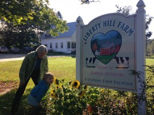 "Grandcations are popular at Liberty Hill Farm in Vermont – Farmer Beth Kennett and her granddaughter Ella at Liberty Hill Farm in Vermont, also a popular ""grandcation"" destination. Photo by Rachel Carter."