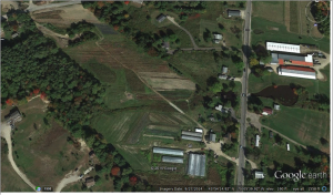 Laughing Stock Farm fields. Permanent beds have been re-oriented to shed water. (Google)
