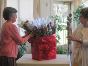 Nancy Richards and Madeleine Hemmings handing out roses for Activity Group Leaders