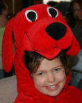 Photo of girl in a dog costume