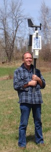 John Gibbons with a Rainwise weather station prior to siting and set up on an apple farm.