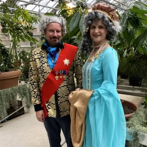 Louis XVI (Ed Cobb) and Marie Antoinette (Karen St. Clair) entertained more than 90 Ithaca High School students who visited the Conservatory Tuesday. The royalty helped the students make connections between their study of the French Revolution and the plants in the Conservatory.