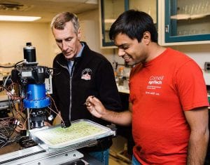 Surya Sapkota and David Gadoury watching like phenotyping robot Blackbird images grape leaf disks.
