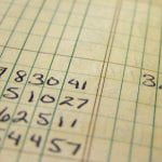 numbers on ledger paper