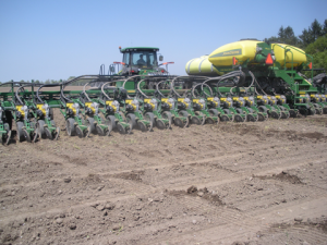 """Planting grain corn with a new 20"""" corn planter in 2013, one of the many new planters purchased in the last few years by corn growers, greatly stimulating the agricultural equipment industry in upstate NY."""