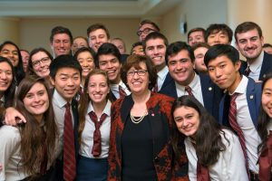 Martha Pollack with Glee Club and Chorus members