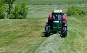 A baler hay bailing a field