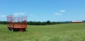 Empty hay wagon on a field
